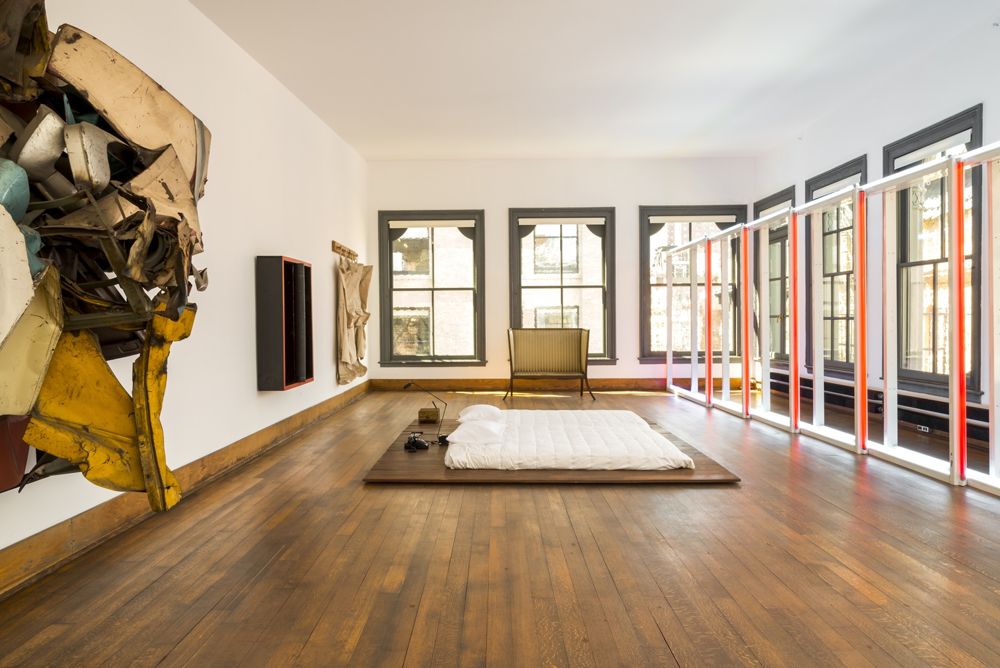 The fifth floor of 101 Spring Street.  Photo credit: Joshua White—Judd Foundation Archives. Image ©Judd Foundation. Flavin artwork © Stephen Flavin/(ARS), © Chamberlain artwork/(ARS, © Claes Oldenburg.
