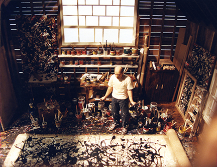 A detail view of <i>Jackson Pollock 1951</i>; showing the artist at work in his studio in Springs, NY.