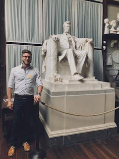 Dorian Sanders next to carving of Lincoln by Daniel Chester French 2018