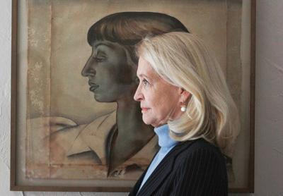 Ruth Appelhof stood next to a portrait of Lee Krasner at the Pollock-Krasner House and Study Center in Springs last month. Durell Godfrey