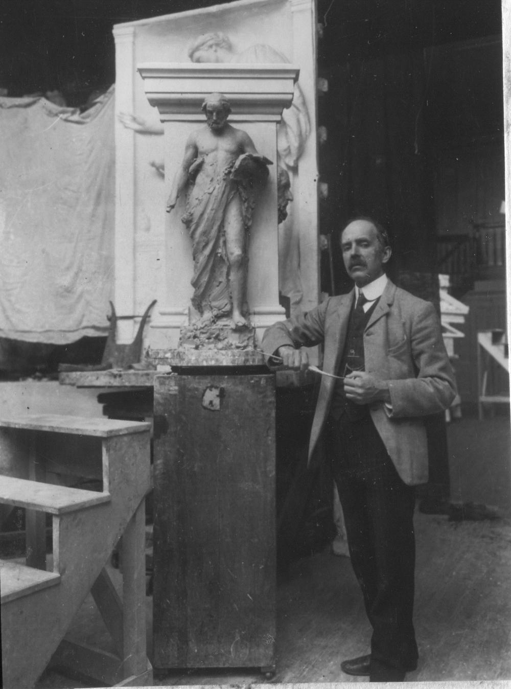 Daniel Chester French with model of Greek Epic Poetry in his NYC studio