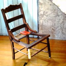 19.	David Ireland, Three-Legged Chair, 1978; wood chair, journal, and metal chain; 30 ½ x 18 x 17 inches; photo: Abe Frajndlich; image courtesy of The 500 Capp Street Foundation.