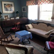 Kent—Fitzgerald Historic Artists' Home, 2017. The living room features Kent's 1850s rosewood-case Raven Bacon & Co. piano, rocking chair, and a Victorian walnut framed wingback sofa. Fitzgerald Legacy Archives.