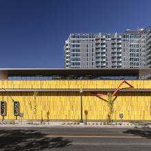 Kirkland Museum of Fine & Decorative Art, Denver. Golden building by Jim Olson of Olson Kundig, featuring Vance Kirkland's historic brick studio & art school building at right.