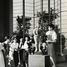 "Chaim Gross working on ""Ballerina"" during the 1939-40 World's Fair in New York City, 1940, imbuya wood, 52 inches high, collection of the Brooklyn Museum. Credit: © Harold Corsini, 1939."