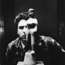 "Chaim Gross posed with ""Girl in Kimono I"", 1937, lignum vitae, 17 inches high, private collection. Credit © Lewis Jacobs, 1938."