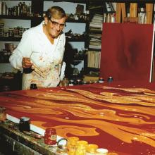 Vance Kirkland painting in his studio, 1979, working on his painting from that year titled Explosions on a Sun 100 Billion Light Years from Earth. Photo by Hugh Grant.