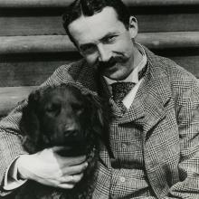 Henry Chapman Mercer and his dog, Rollo on Fonthill Castle steps